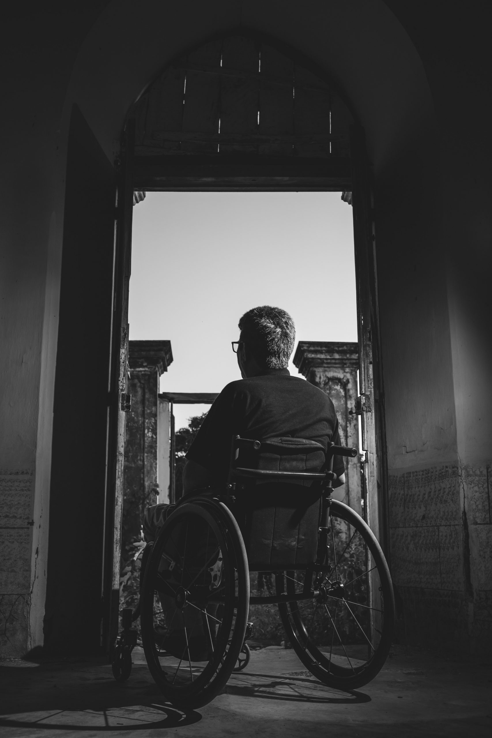 grayscale-photography-of-man-sitting-on-wheelchair-3044623-scaled