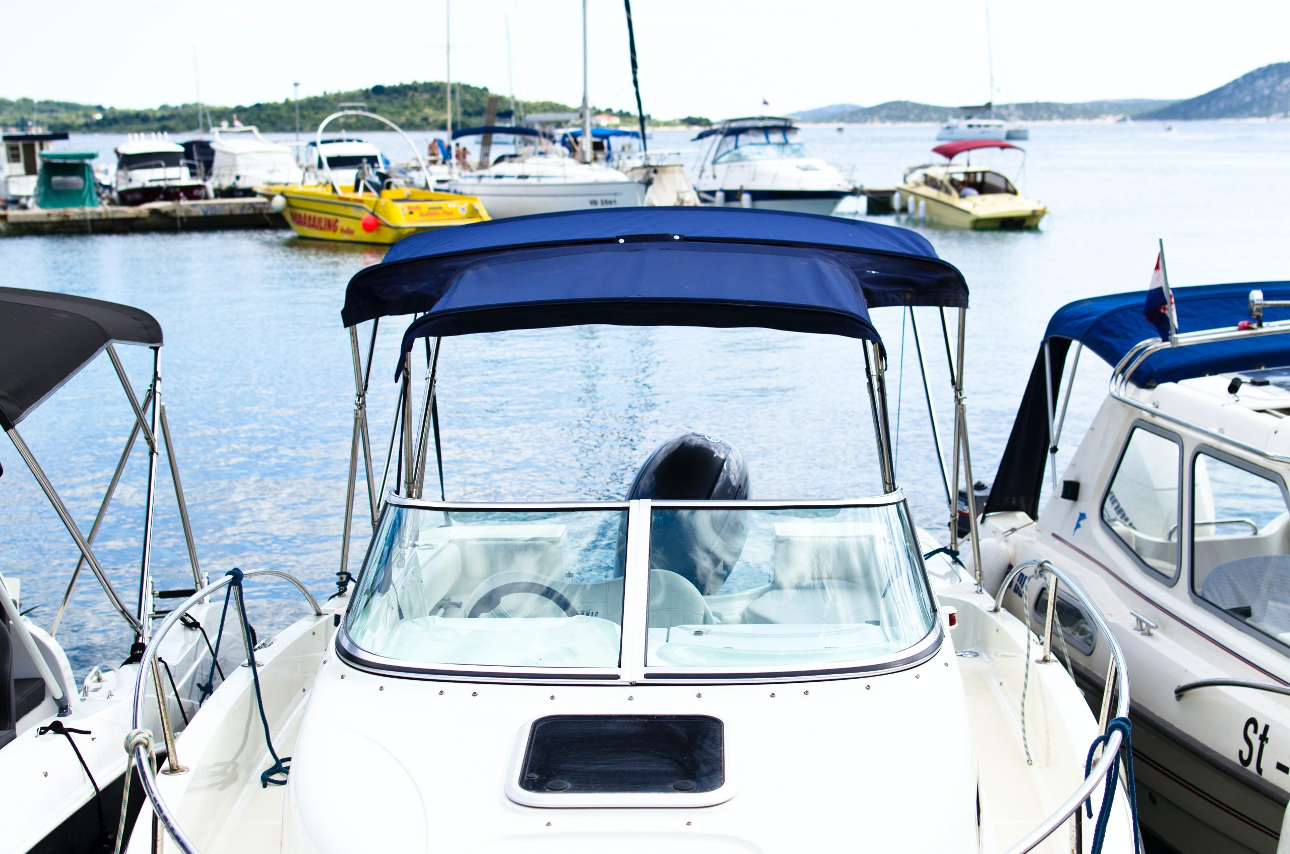 bay-beach-blue-boats-296236-scaled